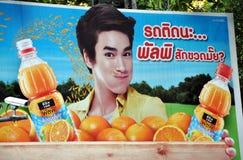 Bangkok, Thailand: Advertising Billboard. A large advertising billboard promoting bottled orange juice overlooks busy Sukhamvit Road in central Bangkok, Thailand Stock Image