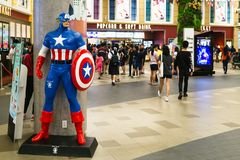 Bangkok, Thailand - Apr 24, 2019: Avengers 4 Endgame character model Captain America in front of the Theatre with People queing up stock images