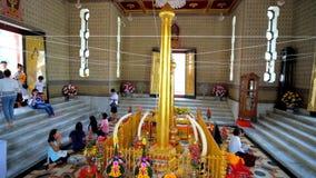 Interior of City Pillar Shrine, Bangkok, Thailand. BANGKOK, THAILAND - APRIL 23, 2019:  The Buddhist devotees with flower offerings in prayer hall of City Pillar stock video