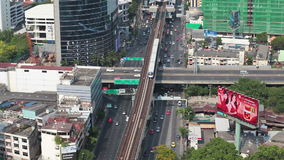 BANGKOK THAILAND - APRIL 11: Business Transportation BTS Railway Road in Building Bangkok city area, panning with tracking high an. Gle shot in HD , Sathorn stock footage