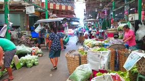 Central Agricultural Market, Bangkok, Thailand. BANGKOK, THAILAND - APRIL 23, 2019: The cart of street drinks seller rides through the alleyway of central Wang stock video
