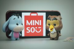 Bangkok, Thailand - April 10, 2021 : Cute figurine of Eeyore and Owl, Winnie the pooh Figures Mystery box Blind box from Miniso