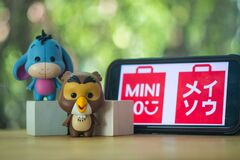 Bangkok, Thailand - April 12, 2021 : Cute figurine of Eeyore and Owl, Winnie the pooh Figures Mystery box Blind box from Miniso