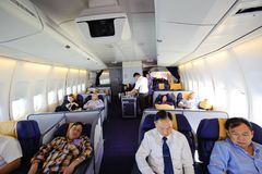 Bangkok, Thailand - April 4, 2012 : In flight of Thai Airways Boeing 747-400 in first classvr.7442 cabin with passengers on boar Royalty Free Stock Photography