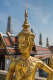 Bangkok, Thailand - April 21, 2015: Golden Kinnari statue outside Buddhist temple in Bangkok's Grand Palace complex, Thailand. Stock Photos