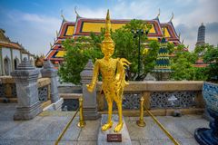Golden statue of Asurapaksi in Grand palace of Bangkok, Thailand Royalty Free Stock Images