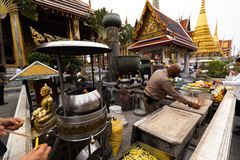 BANGKOK, THAILAND - APRIL 6, 2018: The Grand Palace - Chakri Day - Decorated in gold and bright colors where buddists go royalty free stock photos
