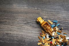 BANGKOK, THAILAND - APRIL 01, 2019 : Group of lego toys and a truck on wooden background royalty free stock photo