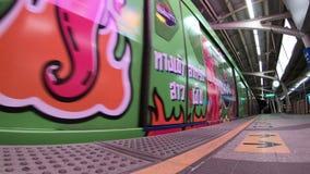 Bangkok, Thailand - April 13, 2018 : Metro train arrives at station in Bangkok as people waiting for doors to open.  stock video