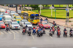 Bangkok, Thailand - April 1, 2017: Motorbikes and cars are stopp. Ing and wait for the green traffic sign at the four junctions at Saladaeng nearby Silom and Stock Image