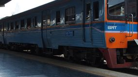A train leaves Hua Lamphong, Bangkok main railway station stock video
