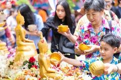 People bathing rite to buddha images stock photo
