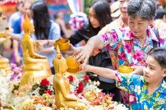 People bathing rite to buddha images royalty free stock image