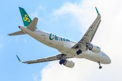 Plane Airbus a320 of Spring Airlines on the sky landing to Suvanabhumi airport. stock photo