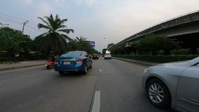 Bangkok, Thailand - April 6, 2018 : The point of view of a motorcycle rider on a road in Bangkok stock video