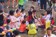 Bangkok, Thailand - April 15, 2019 : Songkran festival or Thai New Year`s festival, Asian Kid Playing water and fountain at stock photo