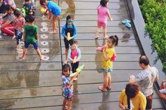 Bangkok, Thailand - April 15, 2019 : Songkran festival or Thai New Year`s festival, Asian Kid Playing water and fountain at royalty free stock image