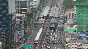 BANGKOK,THAILAND - April 8,2014 :Top view Bangkok and Sky Train of Bangkok going out from station another one going to station stock video footage