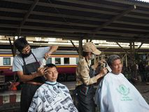 Hair cut at Bangkok main train station stock images