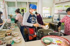 Bangkok, Thailand - April, 24, 2021 : Unidentified name man cooking noodles for selling at Bangkok, Thailand