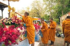 Buddhist Monks sprinkling scented water on the Buddha Image in. BANGKOK,THAILAND- APRIL 12,2015 : Unidentified Thai Buddhist Monks sprinkling scented water on Royalty Free Stock Image