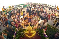 Crowd sprinkling scented water on the Buddha Image in Songkran festival. BANGKOK,THAILAND- APRIL 12,2015 : Unidentified Thai crowd sprinkling scented water on Stock Photography