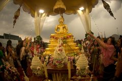 Crowd sprinkling scented water on the Buddha Image in Songkran festival. BANGKOK,THAILAND- APRIL 12,2015 : Unidentified Thai crowd sprinkling scented water on Royalty Free Stock Photo