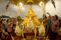 Crowd sprinkling scented water on the Buddha Image in Songkran festival. BANGKOK,THAILAND- APRIL 12,2015 : Unidentified Thai crowd sprinkling scented water on Stock Photos
