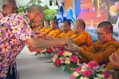 Thai people are Watering for forgiveness and blessings from the Monks in Songkran Festival. BANGKOK,THAILAND- APRIL 12,2015 : Unidentified Thai people pouring Royalty Free Stock Photography