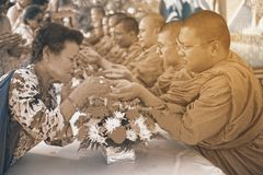 Thai people are Watering for forgiveness and blessings from the Monks in Songkran Festival. BANGKOK,THAILAND- APRIL 12,2015 : Unidentified Thai people pouring Royalty Free Stock Image