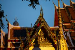BANGKOK, THAILAND - APRIL 6, 2018: Wat Pho buddist temple - Decorated in gold and bright colors where buddists go pray - stock photos