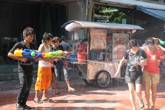 Bangkok, Thailand - April 15: Water fight in Songkran Festival Thai New Year on April 15, 2011 in soi Kraisi, Bangkok, Thailand. Water fight in Songkran Stock Images
