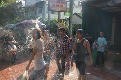 Bangkok, Thailand - April 15: Water fight in Songkran Festival Thai New Year on April 15, 2011 in soi Kraisi, Bangkok, Thailand. Water fight in Songkran Stock Photo