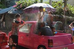 Bangkok, Thailand - April 15: Water fight in Songkran Festival Thai New Year on April 15, 2011 in soi Kraisi, Bangkok, Thailand. Water fight in Songkran Stock Image