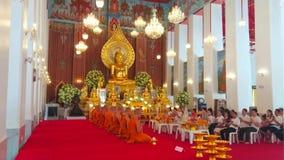 Ubosot of Wat Chana Songkhram, Bangkok, Thailand. BANGKOK, THAILAND - APRIL 23, 2019: The worship in Ubosot of Wat Chana Songkhram monastery, decorated with gilt stock footage