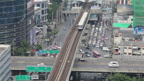 BANGKOK,THAILAND - April 8,2014 :Zoom Top view Bangkok and Sky Train of Bangkok going out from station stock video footage