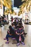 Bangkok, Thailand - Aug 17, 2016: People addicted to smartphone game Pokemon Go, gathered at the park outside Siam Paragon shoppin Stock Photos