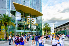 People walk in and out of the Siam Paragon Shopping mall. It is. Bangkok, Thailand - Aug. 18, 2017: People walk in and out of the Siam Paragon Shopping mall. It Royalty Free Stock Photography