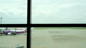 Bangkok, Thailand - August 29, 2019 : Airplane parking at Don mueang International Airport with passenger link for departure