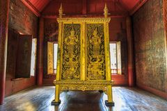 The ancient golden and black Tipitaka Book Cabinet Stock Photo