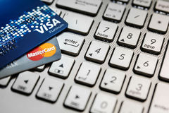 Bangkok, Thailand - August 24, 2017: Close up shot of 2 credit cards VISA and Mastercard on laptop computer with enter button focu Stock Photo
