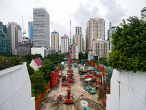 Bangkok, Thailand - August 6, 2017 : A Construction site of building being built during early stage surrounded by complete stock image
