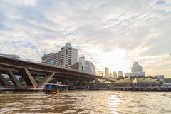 The ferry is docking at Chao Phraya River at the morning. Royalty Free Stock Image