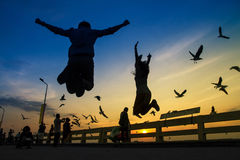 Bangkok,Thailand, - August 25, 2015 : people Jump shot for friend photo at sunset Royalty Free Stock Image