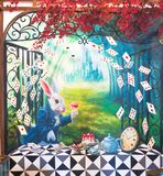 Wall painting of a white rabbit is having a tea party. Bangkok, Thailand - August 12, 2015 : A photo of Alice`s Adventures in Wonderland theme wall painting stock photo