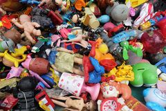 BANGKOK, THAILAND - August 25, 2018 Pile of plastic children`s toys broken or damage are dumped at the 2nd hand shop. For Reuse and Recycle stock image