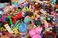 BANGKOK, THAILAND - August 25, 2018 Pile of plastic children`s toys broken or damage are dumped at the 2nd hand shop. For Reuse and Recycle royalty free stock photos