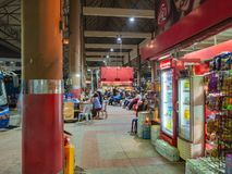 Store and tourist waiting bus on platform in Mo Chit bus station bangkok city thailand. Bangkok/Thailand - 30 August 2018:Store and tourist waiting bus on stock image
