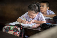 BANGKOK THAILAND - August 23, 2017 : The student girl is studying very concentrate. She do homework in the classroom at Wannawit S. BANGKOK THAILAND - August 23 Stock Image