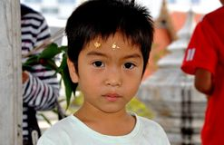 Bangkok, Thailand: Boy with Gold Leaf on Forehead Royalty Free Stock Images